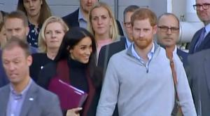 Britain's Prince Harry, centre right, and his wife Meghan, centre left, approach a car at an airport in Sydney, Monday, Oct. 15, 2018. (Australian Pool via AP)