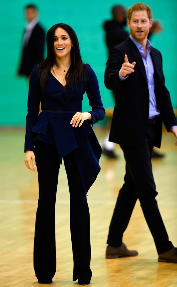 Britain's Prince Harry, Duke of Sussex, and his wife Meghan, Duchess of Sussex, attend the Coach Core Awards at Loughborough University in Loughborough, central England on September 24, 2018