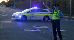 A garda on the road to the sorting centre in Clondalkin. Photo: Damien Eagers