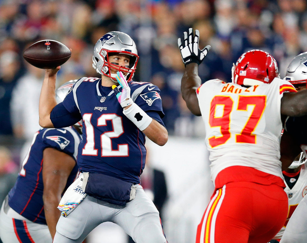 New England Patriots quarterback Tom Brady (12) makes a pass while pressured by Kansas City Chiefs defensive end Allen Bailey (97). Photo: Greg M. Cooper-USA TODAY Sports