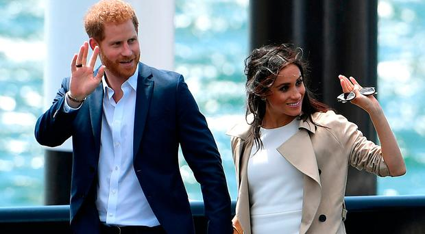 Britain's Prince Harry and wife Meghan arrive for a public walk at the Sydney Opera House in Sydney on October 16, 2018