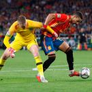 England's Jordan Pickford challenges Spain's Rodrigo in the penalty area after losing the ball