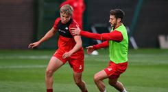 LIVERPOOL, ENGLAND - OCTOBER 15: Paul Glatzel (left) is one of the five Liverpool prospects who trained with the first team alongside star players such as Adam Lallana (right) at Melwood Training Ground on October 15, 2018 in Liverpool, England. (Photo by Andrew Powell/Liverpool FC via Getty Images)