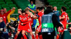 Wales' Harry Wilson (centre) celebrates scoring his side's first goal of the game with team mates during the UEFA Nations League, League B, Group four match at The Aviva Stadium, Dublin.