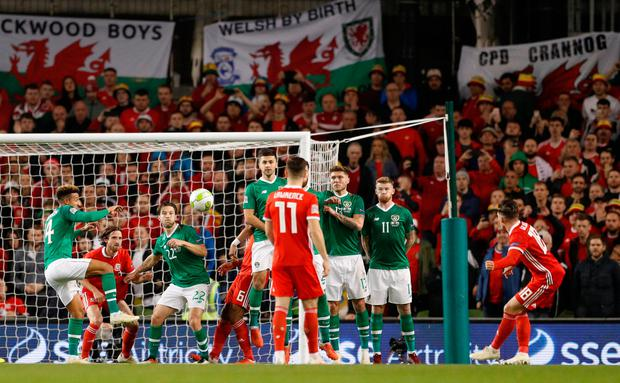 Harry Wilson fires his free-kick over the Ireland wall for the Wales goal at the Aviva Stadium last night. Photo: REUTERS