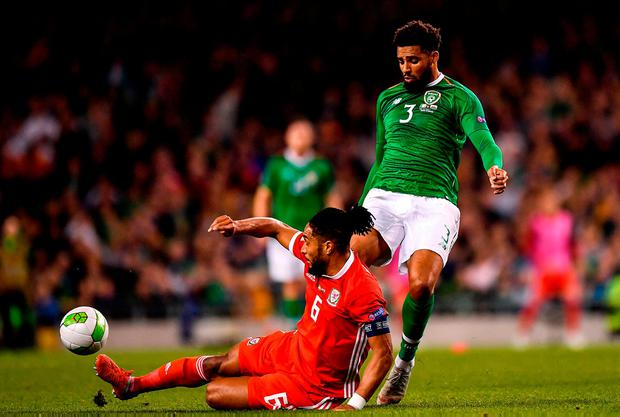 Cyrus Christie is dispossessed by Ashley Williams. Photo: Seb Daly/Sportsfile
