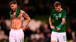 James McClean, right, and Jeff Hendrick leave the pitch following Ireland's defeat to Wales at the Aviva Stadium. Photo: Stephen McCarthy/Sportsfile
