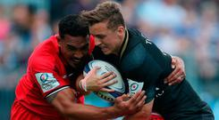 Bath's Darren Atkins is tackled by Toulouse Cheslin Kolbe and Jerome Kaino during the European Champions Cup match at the Recreation Ground, Bath. PRESS ASSOCIATION Photo. Picture date: Saturday October 13, 2018. David Davies/PA Wire.
