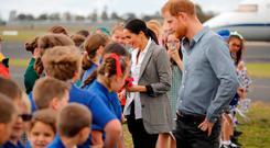The Duke and Duchess of Sussex meet children from Dubbo South Public School after arriving by plane at Dubbo, Australia, on the second day of the Royal couple's visit to Australia. Photo: Phil Noble/PA Wire