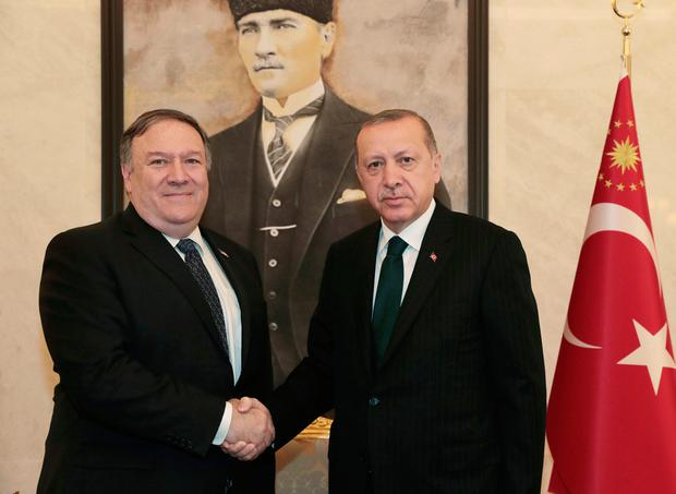 Discussions: Turkey's President Recep Tayyip Erdogan, right, and US Secretary of State Mike Pompeo shake hands. Photo: AP
