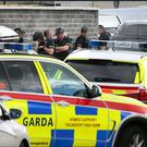 Armed Garda pictured at the scene where a man barricaded him self into a house