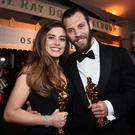 HOLLYWOOD, CA - MARCH 04: Academy Award winners Rachel Shenton (R) and Chris Overton pose with awards for Best Live Action Short Film 'The Silent Child' at the 90th Annual Academy Awards Governors Ball at Hollywood & Highland Center on March 4, 2018 in Hollywood, California. (Photo by Kevork Djansezian/Getty Images)