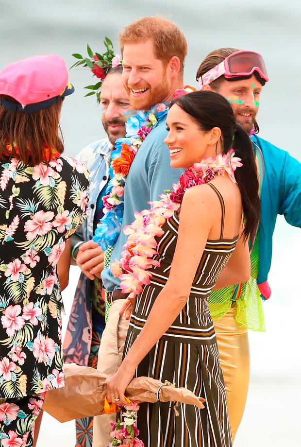 Prince Harry, Duke of Sussex and Meghan, Duchess of Sussex talk to OneWave members, a local surfing community group raising awareness for mental health and wellbeing on Bondi Beach on October 19, 2018