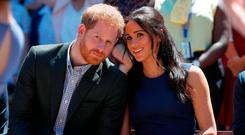 The Duke and Duchess of Sussex watch a performance during their visit to Macarthur Girls High School in Sydney on the fourth day of their visit to Australia