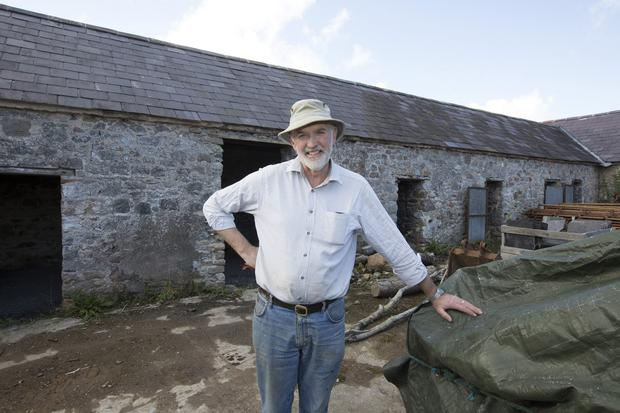 William Hunter outside the old piggery on his farm at Ballylooby, Cahir, Co Tipperary. Photograph Liam Burke