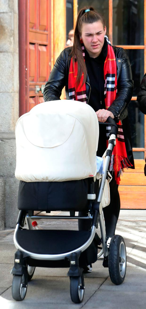 Rebecca Kelly, 20, of Pearse House, Pearse Street, Dublin pictured leaving the Four Courts after she was awarded €550,000 damages following a High Court action. Pic: Collins Courts