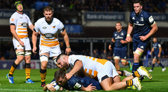 12 October 2018; Luke McGrath of Leinster scores his side's second try despite the tackle of Kieran Brookes of Wasps during the Heineken Champions Cup Pool 1 Round 1 match between Leinster and Wasps at the RDS Arena in Dublin. Photo by Ramsey Cardy/Sportsfile