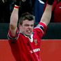Munster's Mossy Lawler celebrates scoring a try against Gloucester at Thomond Park in January 2003