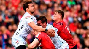 Rory Scannell of Munster is tackled by Danny Cipriani of Gloucester, left, and Josh Hohneck, right, during the Heineken Champions Cup Round Pool 2 Round 2 match between Munster and Gloucester at Thomond Park in Limerick. Photo by Sam Barnes/Sportsfile