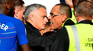 Manchester United manager Jose Mourinho is restrained by stewards after reacting to Chelsea's second goal