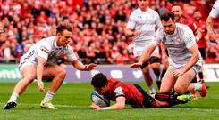 Joey Carbery of Munster scores his side's third try despite the efforts of Callum Braley, left, and Mark Atkinson of Gloucester during the Heineken Champions Cup Pool 2 Round 2 match between Munster and Gloucester at Thomond Park in Limerick. Photo by Diarmuid Greene/Sportsfile