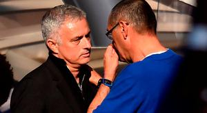 Manchester United's manager Jose Mourinho (L) shakes hands with Chelsea's Maurizio Sarri
