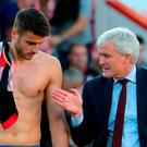Southampton's Wesley Hoedt (left) and manager Mark Hughes after the final whistle