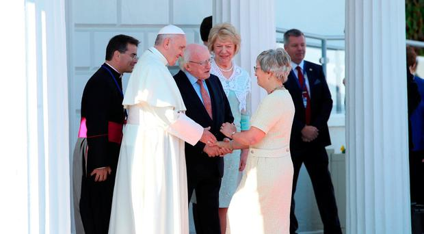 WARM WELCOME: Children's Minister Katherine Zappone meets Pope Francis watched by President Michael D Higgins and his wife Sabina at Aras an Uachtarain on August 25. Photo: Danny Lawson/PA Wire