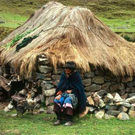 EXPEDITION: A farmer sits outside his home in Peru