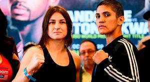 Katie Taylor and Cindy Serrano, right, square off after weighing in at the Boston Harbour Hotel ahead of their WBA & IBF World Lightweight title bout on Saturday night at the TD Garden in Boston, Massachusetts, USA. Photo by Stephen McCarthy/Sportsfile