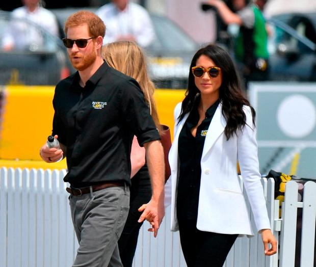 BREAKING THE MOULD: Harry and Meghan Markle on tour in Oz. Photo: Dominic Lipinski/PA Wire