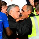 Jose Mourinho is restrained by stewards after reacting to Marco Ianni's celebration of Chelsea's late equaliser. Photo: Reuters