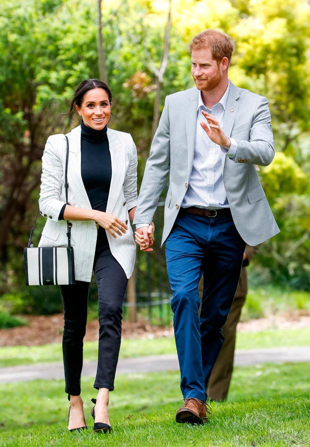 Britain's Prince Harry and Meghan, Duchess of Sussex, hold hands while walking through Sydney Olympic Park, Australia October 21, 2018. Chris Jackson/Pool via REUTERS