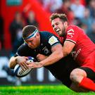 Seán Cronin of Leinster goes over to score his side's third try despite the efforts of Zack Holmes of Toulouse during the Heineken Champions Cup Pool 1 Round 2 match between Toulouse and Leinster at Stade Ernest Wallon, in Toulouse, France. Photo by Brendan Moran/Sportsfile