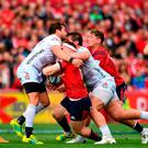 Rory Scannell being tackled in the incident that resulted in Danny Cipriani (left) being shown the red card at Thomond Park. Photo: Sam Barnes/Sportsfile