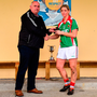Mayo Ladies' County Board secretary Kevin McDonnell presents the player of the match award to Cora Staunton of Carnacon. Photo: Sportsfile
