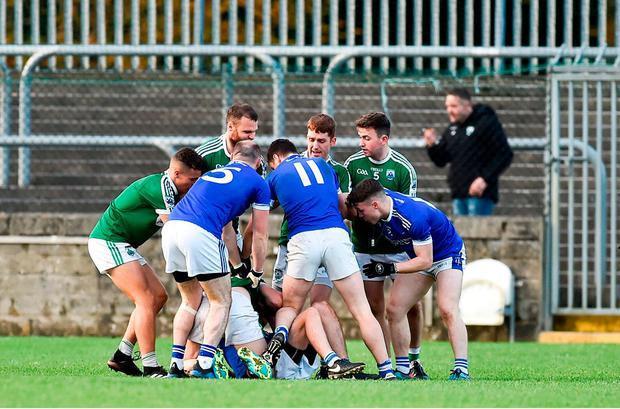Players from both sides involved in a dispute which lead to a red card for Cian Mulligan of Gaoth Dobhair during the Donegal County Senior Club Football Championship Final. Photo: Oliver McVeigh/Sportsfile