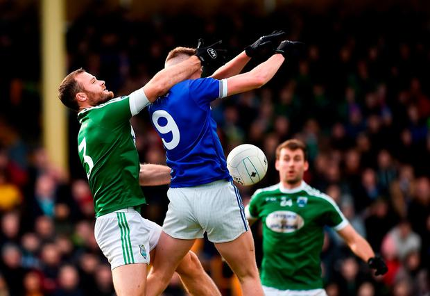 Gaoth Dobhair's Neil McGee and Kieran Gallagher of Naomh Conaill Glenties battle for possession. Photo: Oliver McVeigh/Sportsfile