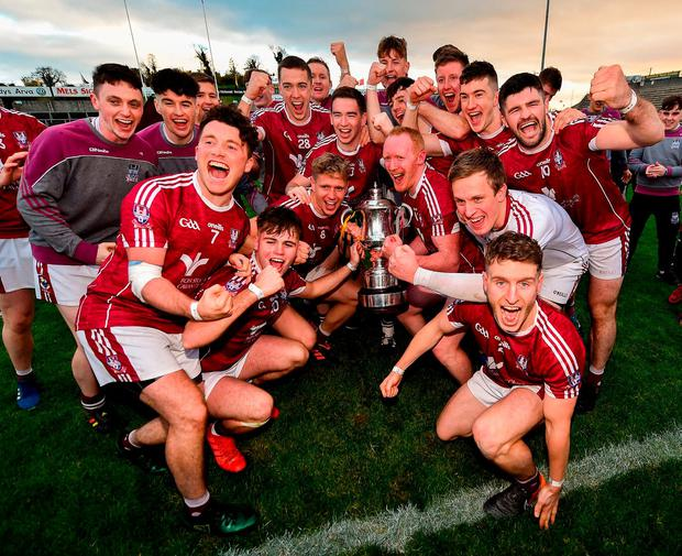 Castlerahan players celebrate with the Oliver Plunkett Cup after their victory in the Cavan SFC final. Photo: Seb Daly/Sportsfile
