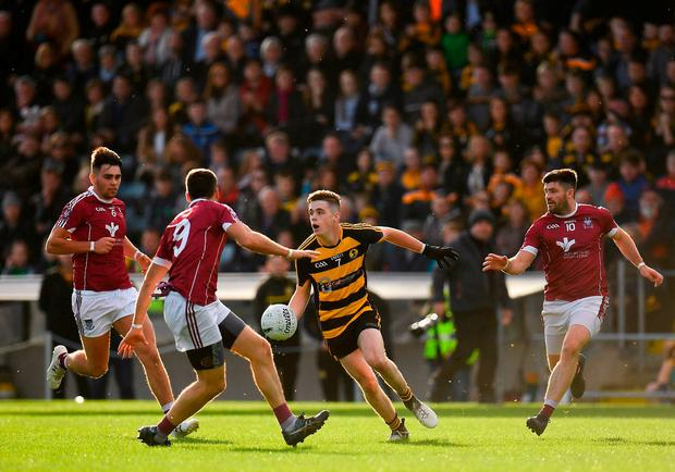 Shane McVeety of Crosserlough looks for a way out as he's closed down by Cormac Daly, left, Pauric Smith, centre, and Shane McSweeney. Photo: Seb Daly/Sportsfile