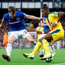 Seamus Coleman fouls Wilfried Zaha to concede a penalty during his comeback for Everton at Goodison Park. Photo: Reuters
