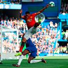 Anthony Martial performs a version of football ballet as he battles it out with Antonio Rudiger at Stamford Bridge. Photo: Getty Images