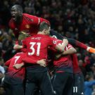 MANCHESTER, ENGLAND - OCTOBER 06: Romelu Lukaku celebrates with team-mates. (Photo by Matthew Peters/Man Utd via Getty Images)