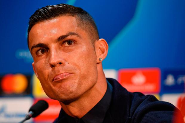 Juventus' Portuguese striker Cristiano Ronaldo gestures during a press conference at Old Trafford in Manchester, north west England on October 22, 2018, on the eve of their UEFA Champions League group H football match against Juventus on October 23. (Photo by Oli SCARFF / AFP)OLI SCARFF/AFP/Getty Images