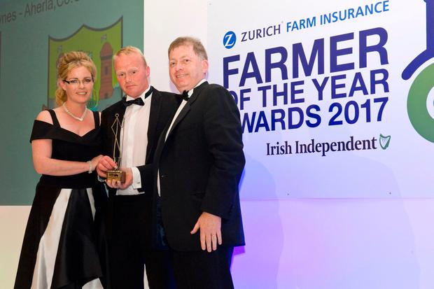 2017 Farmer of the Year Winner Peter Hynes, pictured with his wife Paula, as the collect the trophy from Anthony Brennan, CEO of Zurich in Ireland
