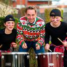 Ryan Tubridy with Ellie Chapman and Joshua O'Neill from Drumadoir Drummers at the first day of 'The Late Late Toy Show' audition tour at the Strand Hotel in Limerick. Photo: Oisin McHugh