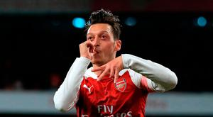 Arsenal's Mesut Ozil celebrates scoring his side's first goal of the game during the Premier League match at the Emirates Stadium, London. PRESS ASSOCIATION Photo. Mike Egerton/PA Wire.