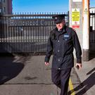 Crime scene: A garda at the Homestead Court apartments in Cabra, Dublin. Photo: Colin Keegan, Collins