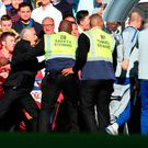 Stewards hold back Jose Mourinho. Photo: Catherine Ivill/Getty Images