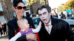Six-month-old Cuan Curran and mum Helen O'Brien meet Dracula (David Hurlihy) as a plaque and mural are unveiled to commemorate Bram Stoker in Buckingham Street in Dublin's inner city. Photo: Justin MacInnes